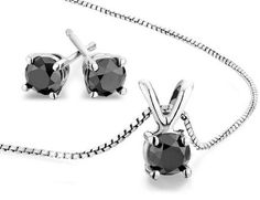 A picture of elegance and simplicity, this stud earring and necklace set features 1.0 carat (ctw) solitaire black diamonds in a classic four-prong sterling silver setting. Take her breath away with this sophisticated ensemble. View item video above. SKU: 61BE0100100