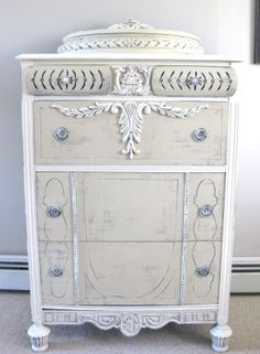 Annie Sloan Chalk Paint™ tall dresser The colors used were Old White and Country Grey.