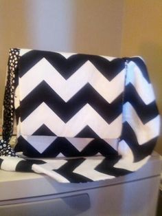 Chevron reversible purse with side pockets.