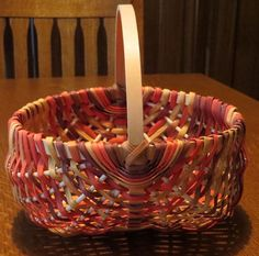 Egg Basket - I wanted to learn how to do this, but the reed in the kit I got was being difficult, so I used some leftover space-dyed reed instead.