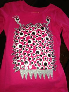 100th Day of school shirt with 100 googly eyes! Drew the monster on with permanent sharpie and then used glitter puffy paint to outline marker & fill in teeth. Then hot glued google eyes to monster.