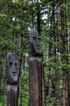 """Evenk shaman totems at the Village """"Angarskaya"""" in Bratsk, Russia - photo by Alexey Trofimov (Alex El Barto), via Flickr;  The outdoor Museum of Architecture and Ethnography consists of 2 sections: the Evenks sector and Russian village. Evenks are one of the aboriginal nations of Siberia. In the Evenks sector different types of dwellings, storehouses, sacred places, household articles are displayed."""