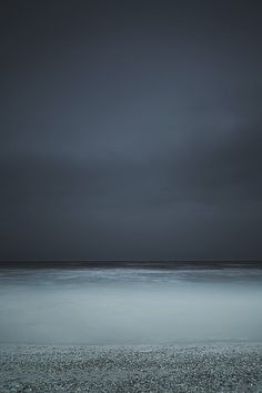 Dark waters turning in the storm, person in that, they wait and ocean turns completely clear and glowing