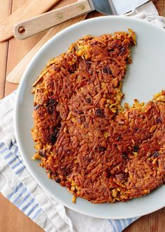 Hash browns are classic home-style diner food. But it takes an astonishing amount of butter to create those crispy, pan-fried cakes of shredded potatoes! This recipe from my first cookbook, Not Your Mother's Casseroles, lightens up the classic hash browns a little by baking them in the oven instead of frying them. It's an easier method for making hash browns that are crispy, but just a little bit lighter.