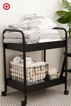 Ever thought of putting a bar cart in the bathroom? It's actually an easy storage solution for organizing towels or toiletries that also adds a chic, spa-like feel.