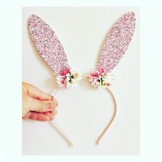 Bunny Headband This listing is for a Bunny Headband . Featuring two glitter bunny ears with soft felt backing on a headband (elastic or ribbon