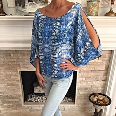 stunning blue snakeskin cold shoulder blouse! Flattering fit- cold shoulder with pretty back tie! I love this piece! Tops Blouses