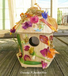 Flower covered bird house- could also be used in a fairy garden or other play scene.
