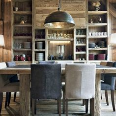 Love the rusticity of this gorgeous dining space, and those open shelves are both practical and gorgeous.