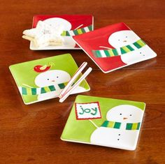 """SNOWMAN PLATES--Serve up holiday cheer with these handpainted ceramic plates. Each plate with a different design. Dishwasher safe. Imported. 6"""" square, Set of 4."""