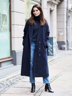 Long navy coat, navy roll neck, blue jeans & black ankle boots | @styleminimalism
