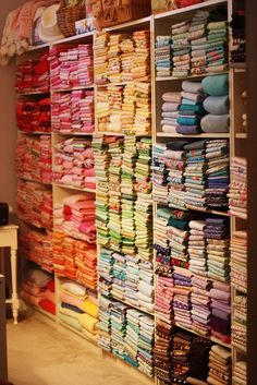 """The Great Wall of Fabric""...color coded, just like you like it.    Oh my goodness I am literally drooling bc this is so incredibly awesome!"