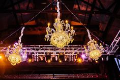 Chandeliers were hung from the lighting truss at The Paramount (Huntington, NY) to give a more romantic feel to a wedding hosted there. #chandelier #lighting #wedding