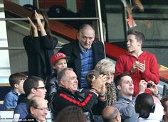 family outing.Victoria was seen standing up to cheer on her husband during one particular point in the game
