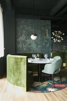 La Forêt Noire - Lyon / Wallcovering - Midsummer Night by  Wall&Deco / banquette in green velvet by Pierre Frey / lighting - Magic Circus by Marie-Lise Fery / carpet rug - Palm by DimoreStudio / design by http://www.claude-cartier.com/accueil / Found on http://www.thesocialitefamily.com/journal/la-foret-noire-restaurant-chaponost/