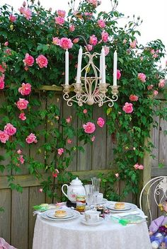 Area between the two Buildings - Small Round Table - Chandelier - Trailing Roses over an old looking Fence Beautiful!