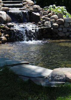 How to build a backyard water garden pond. You will be enjoying your own waterfall with the soothing sounds of rushing water right in your own backyard. Small Yard Landscaping, Hillside Landscaping, Landscaping With Rocks, Outdoor Ponds, Ponds Backyard, Pond Construction, Fish Pond Gardens, Garden Pond Design, Fish Ponds