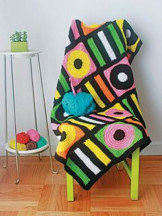 I had never made an afghan before I designed this one! If this is also your first afghan, you're in for a treat. I've always loved the bright, bold colors of licorice allsorts candies. Their simple shapes and stripes make for two square motifs that we can use to create a fabulous candy blanky. Start small (12 squares for a small afghan) or go big (as many as you want). Drape it over your favorite armchair or cover the whole couch. We'll use six colors to represent our candies, but ultimately…