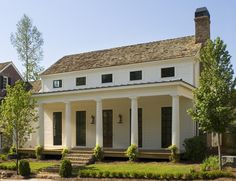 Greek Revival designed & built by Atlanta-based Hedgewood Homes in the planned community of Vickery in Forsyth County, GA. Note floor-length windows below & eyebrow windows above along with Doric columns. Fresh Farmhouse, Modern Farmhouse, Farmhouse Style, Modern Porch, Cottage Farmhouse, Cottage House, Greek Revival Architecture, Architecture Details, Classical Architecture