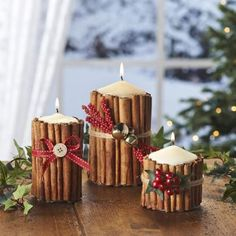 cinnamon candles w/ ribbon, button, bells and berries