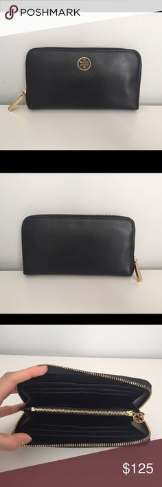 Tory Burch Black Robinson Zip Continental Wallet 100% authentic Tory Burch. A cutout logo medallion gleams against crosshatch-textured Saffiano leather that comprises a sleek zip-around accordion wallet. Interior zip and currency pockets; eight card slots. Tory Burch Bags Wallets