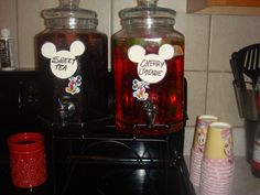 drinks with Mickey Mouse labels...all the food was labeled with these.  I cut out a mickey head and glued it to the mickey toothpicks you get in the cupcake liners kit...then I attempted to write in Disney font :)