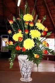 > www.scentimentsflowers.com dashing asymmetrical flower arrangement