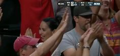 Aaron Rodgers and Olivia Munn Fired Up at Badgers Game -- Green Bay Packers quarterback Aaron Rodgers and arm candy Olivia Munn were fired up watching the Wisconsin Badgers dispatch the North Carolina Tar Heels in the NCAA Tournament.