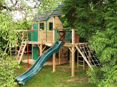 The Forest Mega Combo Climbing Frame and Playhouse with slide and a wooden clatter bridge to a separate tower is one of our favourite Childrens Playhouses