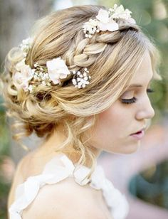 This is a great pinned up hairstyle and the baby breath flowers would look great at a country wedding that incorperates baby breat flowers.