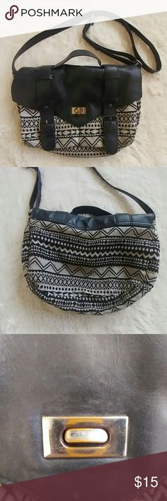 H&M Aztec crossbody bag Divided by H&M Aztec print black and tan cloth and polyester slouchy bag. The front buckles snap closed and there's a metal twist closure with some scratches (see photo). Pockets under the flap and tons of room inside. 14 inches wide, 10 inches tall. Long crossbody adjustable strap. Great condition with some small signs of wear. H&M Bags Crossbody Bags