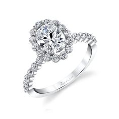 This gorgeous oval engagement ring features a 1.5 carat oval diamond center in a trendy single prong halo. Pair it with it's matching band in a mixed metal for a trendy stylish look! The total carat weight of this stunning oval halo engagement ring is 0.57 carats. Unique Halo Engagement Ring | 1.5 Carat Oval Diamond Center Engagement Rings | Sylvie Collection
