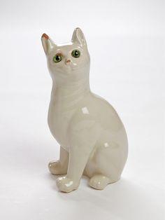 Emile Galle cat  Emile Galle Creation date: 1870 Measurement : 35.00 x 0.00 x 0.00 cm Catégory : Animal art Technique : Modelled Main material : Earthenware / Faience Price: 6,400 €