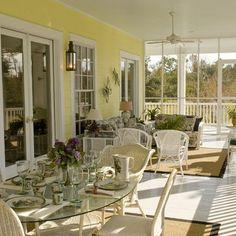 Separate zones for dining and seating.  I wonder how big this porch is.