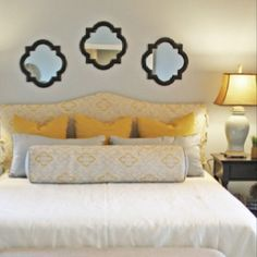 Mirrors over bed