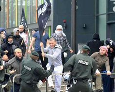 A picture that purports to be of refugees carrying Isis flags and attacking police has been shared widely on social media this week — but the picture is old, probably doesn't show an Isis flag, and has nothing to do with refugees.