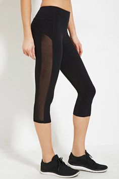 A pair of athletic capri leggings crafted from a stretch knit with mesh-paneled sides and a hidden key pocket.