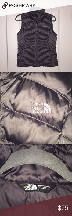 The North Face puffy vest!! LIKE NEW! Cute & WARM north face puffy vest. This is a cool gray color. Front zip and 2 pockets that have zippers as well. I'm not sure what style this is in particular. Only flaw is one seam on the right shoulder is coming up as shown in the photo. Make offers!! The North Face Jackets & Coats Vests