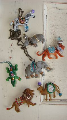 Circus Animal Necklaces. Just like Anthropology only half the price just ordered one!!!! 18.99, via Etsy.