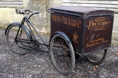 1905 Alldays 'Standard' Carrier Tricycle. The industrial tricycle was developed in England in the 1870s. It was commonly used by grocers, bakers, druggists and other tradesmen.    By 1939, in London, there were 4,000 ice cream tricycles. Delivery tricycles are still used all over the world, but especially in Asia where they can carry loads of up to 1,000 pounds.