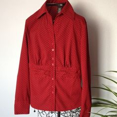 Long sleeve blouse. Reddish print, gathered waist. Long sleeve, button front blouse. Two button sleeve opening. Has gathers/rouching front and back at waist. Slightly scallop hem. Deep color more like wine or burgundy. Like new condition. east 5th Tops Blouses
