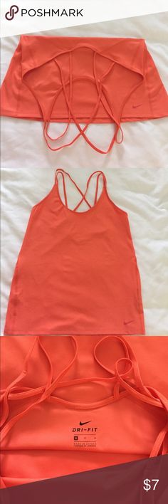 NWOT Nike Dri-fit exercise tank. Never worn. Nike dri-fit exercise tank. Loose fit. Size medium Nike Tops Tank Tops