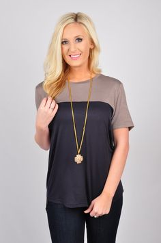 Our Roll With It Top is that go-to top in your closet! You can dress it up with some of our easy accessories, or dress it down and pair it with something more casual. Either way, just roll with it! This top features a two-toned color block. With short, sleeves, and a round neck, this low knitted darting detailed top is made out of 100% Rayon. Machine-wash cold. Flat dry.