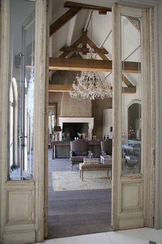 Exposed beams. French doors.