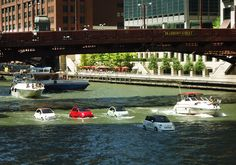 August 5th, 2013 – Onlookers along the Chicago River couldn't believe their eyes on Sunday afternoon when a fleet of little red, cream, and mint colored cars appeared to be driving on the river! At a closer glance, it was clear that the playful crew of floating cars were actually a boat version of Fiat's new collection of 2014 models, which are set to hit the US market later this year