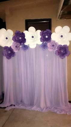 White and purple paper flowers backdrop