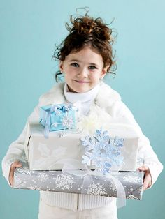 Top holiday packages with snowflake ornaments for a festive touch in cool colors. Here's how: http://www.bhg.com/christmas/indoor-decorating/cool-blue-and-white-for-the-holidays/?socsrc=bhgpin121514snowflakegifttoppers&page=5