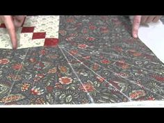 Jamie demonstrates marking and sewing Piano Keys on a quilt.