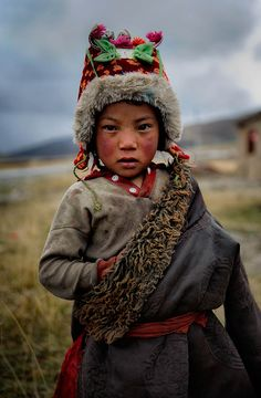 Tibetan kid on traditional clothes. Tibetan plateau A journey through remote lands...