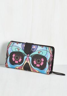 Eye of the Be-bolder Wallet. Featuring a colorful sugar skull and a subliminal butterfly design, this wallet welcomes you to fall in love with its wonderful design! #multi #modcloth